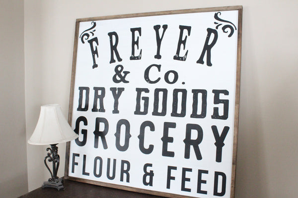 "Family Name, Grocery Flour and Feed 30""x30"" Framed Sign"