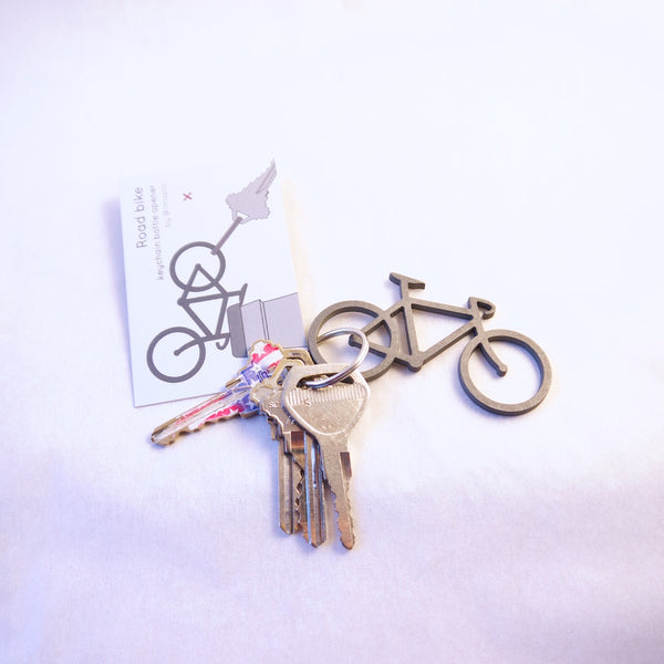 Road bike keychain bottle opener