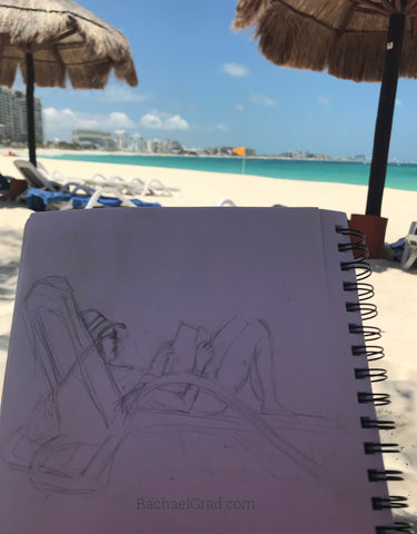 Drawings on the Beach in Mexico woman reading pencil