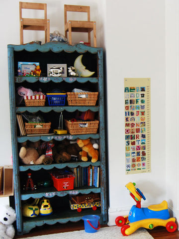 turquoise bookshelf in kids room photo by artist rachael grad children decor bedroom