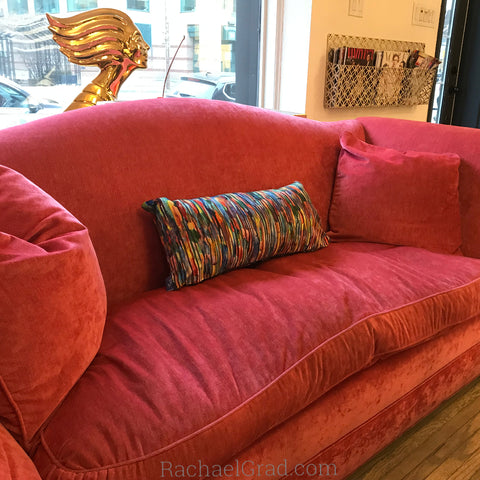 abstract multicolor pillow on pink couch by artist rachael grad yorkville toronto