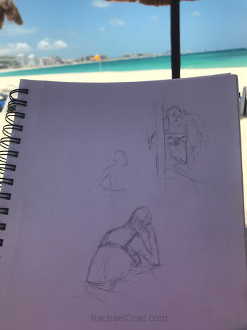 Drawings on the Beach in Mexico Man reading pencil woman