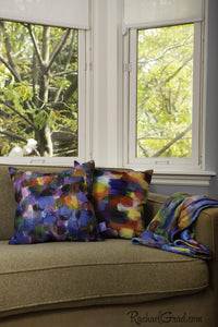 Colorful Art Pillows and Blanket by Artist Rachael Grad on Green Couch
