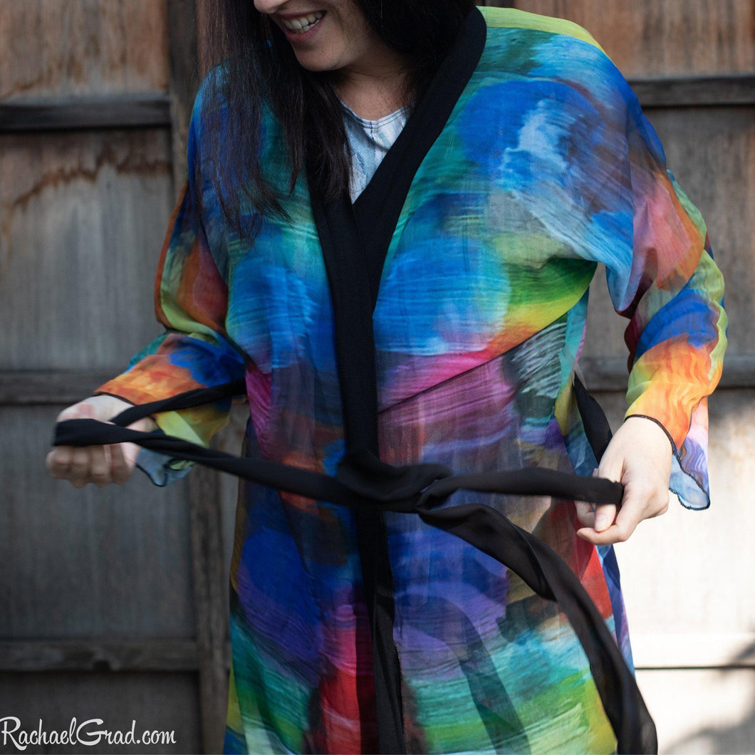 Artist Rachael Grad in colorful bathrobe tying the robe