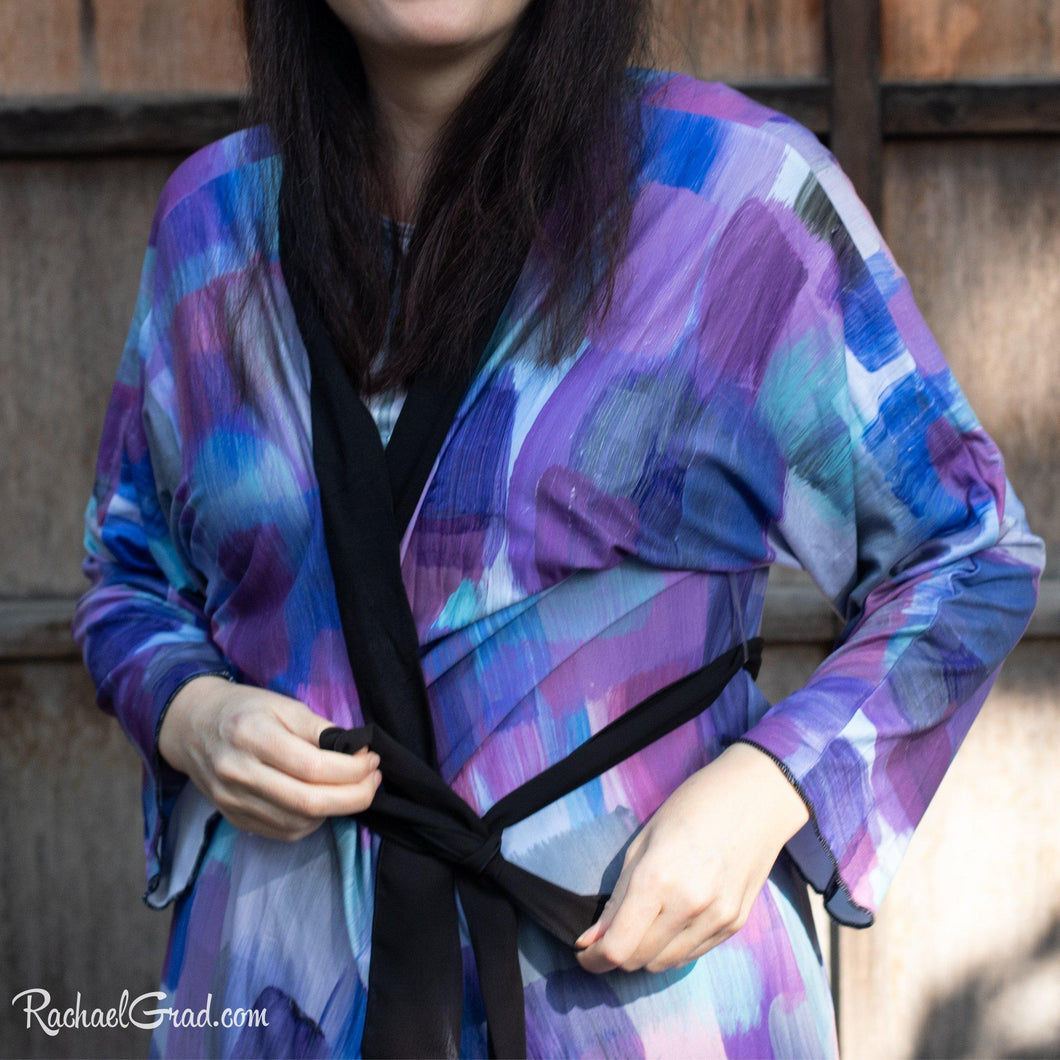 Artist Rachael Grad in purple brushstrokes bathrobe