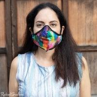 Artist Rachael Grad in rainbow face mask front view