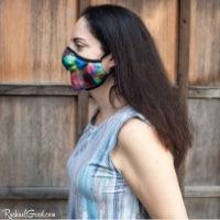 Artist Rachael Grad in rainbow face mask side view