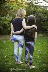 green and black art leggings by artist rachael grad on mom and daughter back view