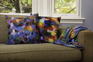 Color Art Pillows and blanket on Green Couch by Toronto Artist Rachael Grad