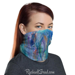 Face mask with full coverage in blue green art by artist Rachael Grad side view on woman