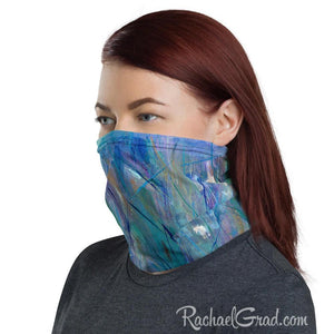 Face mask with full coverage in blue green art by artist Rachael Grad side view