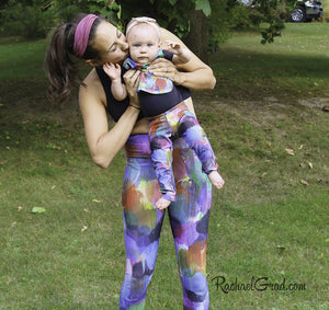 Baby Leggings in Multicolors by Toronto Artist Rachael Grad mom kissing baby