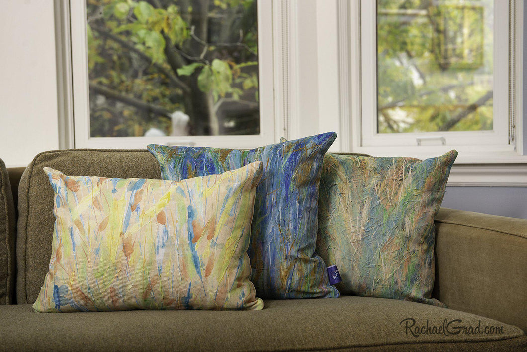 Pillow Group Spring Collection, pillows on green couch by Artist Rachael Grad