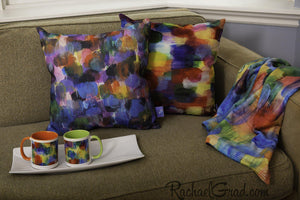 Pillows, blanket and mugs by Artist Rachael Grad on couch