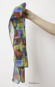 Primary Colors Art Scarf held in hand by Artist Rachael Grad