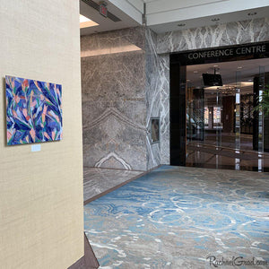 Purple Flowers Abstract Art by Artist Rachael Grad outside the conference centre of the Hilton Toronto Markham Suites