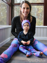 Load image into Gallery viewer, Valentines hearts leggings on Mom and Baby by Artist Rachael Grad  with matching beanie hat
