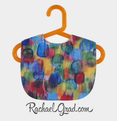 Colorful Baby Bib on Orange Hanger by Toronto Artist Rachael Grad