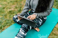 Load image into Gallery viewer, black and white women's yoga leggings by Canadian Artist Rachael Grad on seated woman