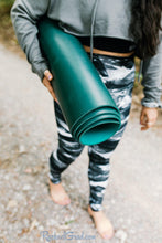 Load image into Gallery viewer, black and white women's yoga leggings by Canadian Artist Rachael Grad with yoga mat