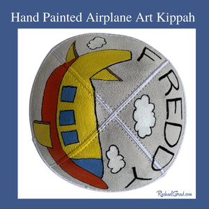 hand painted airplane art kippah by Toronto artist Rachael Grad for Freddy side view