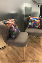 Load image into Gallery viewer, Bold Multicolor Pillows by Toronto artist Rachael Grad on Grey Chairs