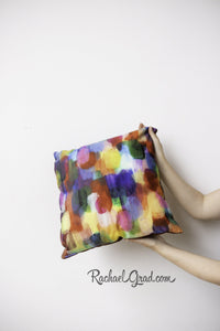 Colorful Art Pillow in 2 Hands by Toronto Artist Rachael Grad