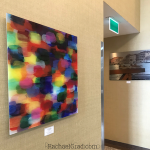 old shoes and abstract art print closeup by artist rachael grad on view in hotel hilton toronto/markham conference centre & spa