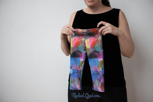 Sami Baby Leggings Tights Newborn Size by Artist Rachael Grad held up by mom