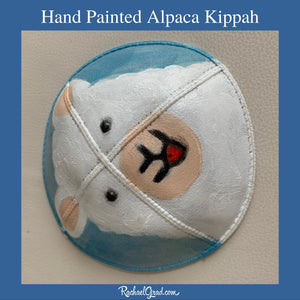 side view hand painted alpaca kippah by artist Rachael Grad Alpaca yarmulkas blue and white