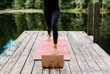 Load image into Gallery viewer, yoga mat by Canadian artist Rachael Grad for pilates on demand on the dock in summer