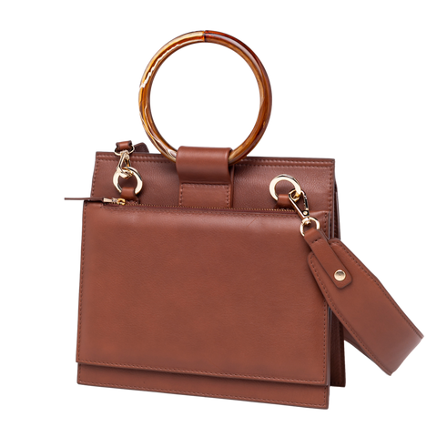 Shellac is sophisticated crossbody handbag. An exquisite limited edition handmade in Barcelona in brown color.
