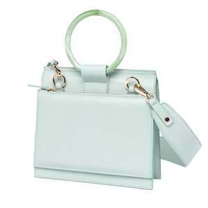 Shellac is a special crossbody handbag in calf leather. A sustainable limited edition handcrafted in Barcelona in mint color. Slow design.