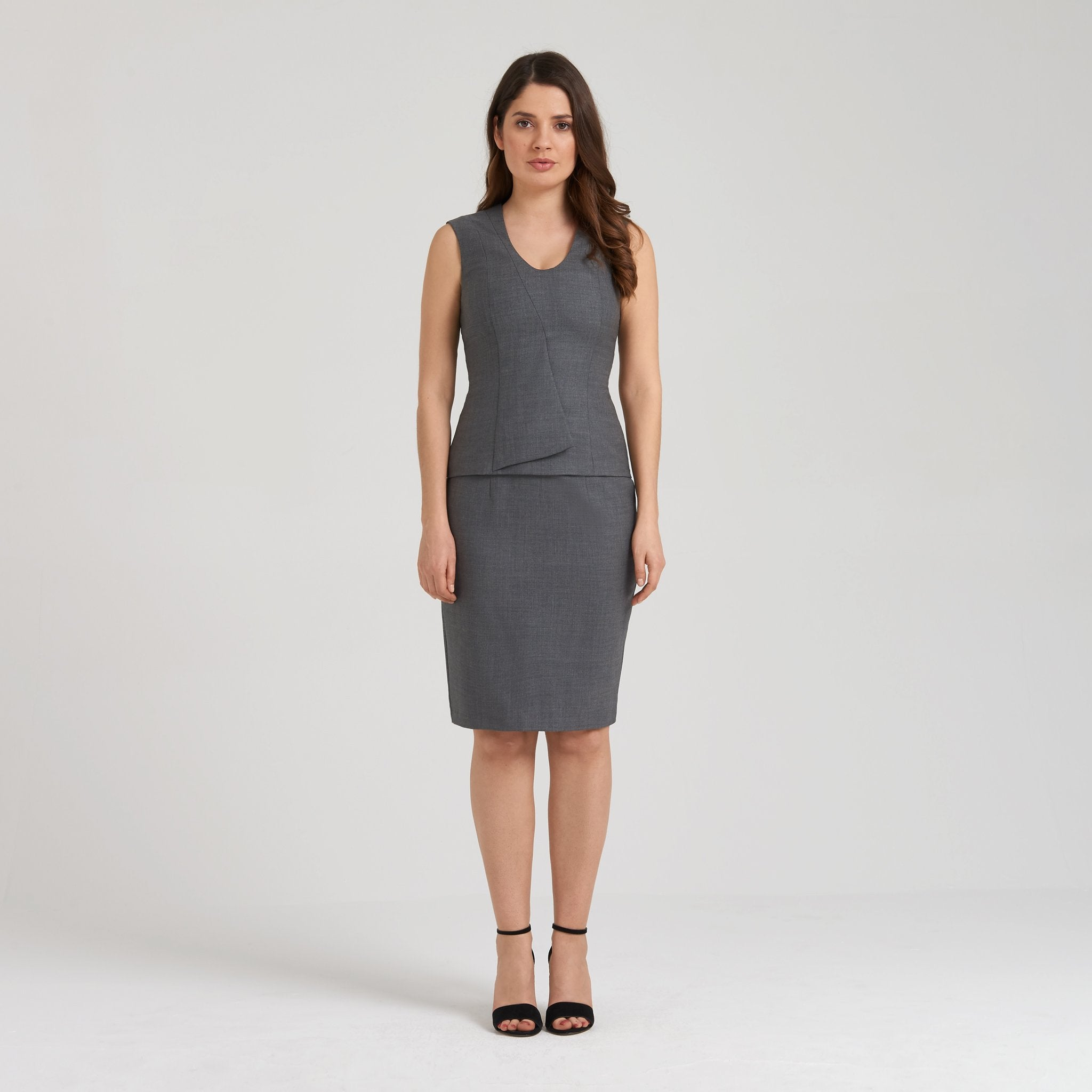 V-neck peplum grey top with a touch of stretch, breathable and thermoregulator