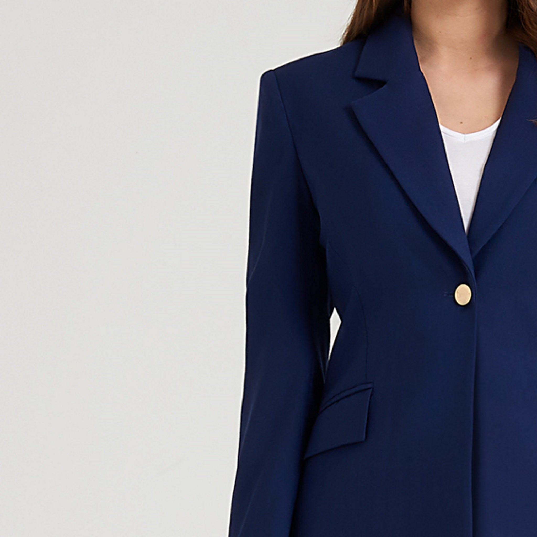Breathable blue blazer with statement golden buttons and functional angled flap pockets