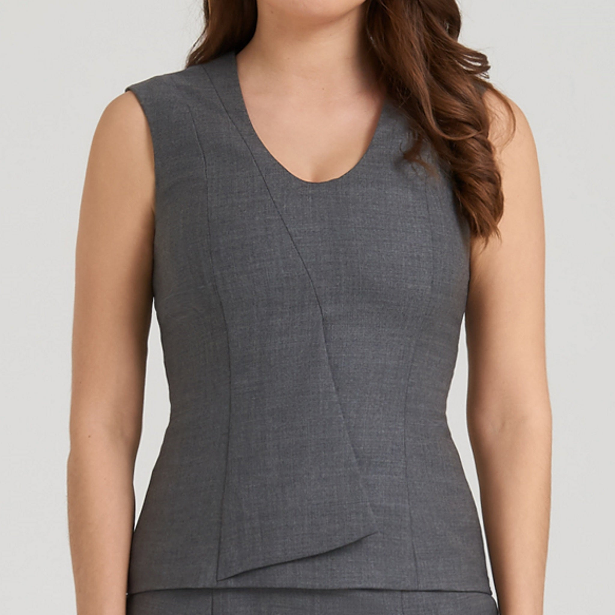 V-neck peplum blue top with a touch of stretch, breathable and thermoregulator
