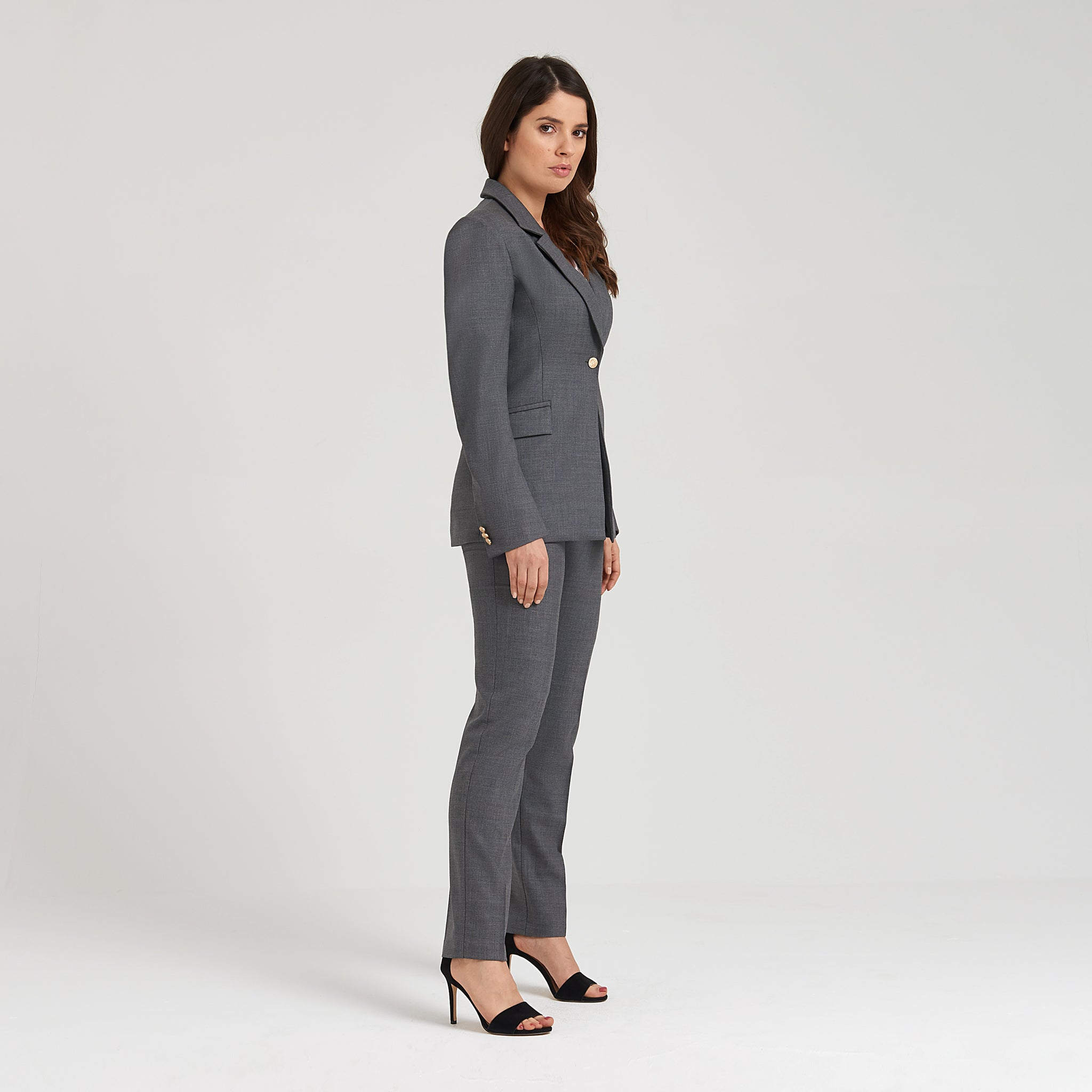 Breathable grey blazer with statement golden buttons and functional angled flap pockets