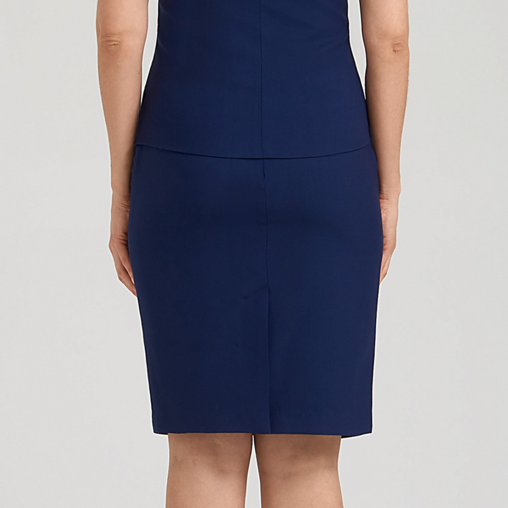 Blue pencil skirt finished for unrestricted movement and next-to-skin comfort