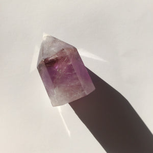 amethyst crystal point with white and purple details