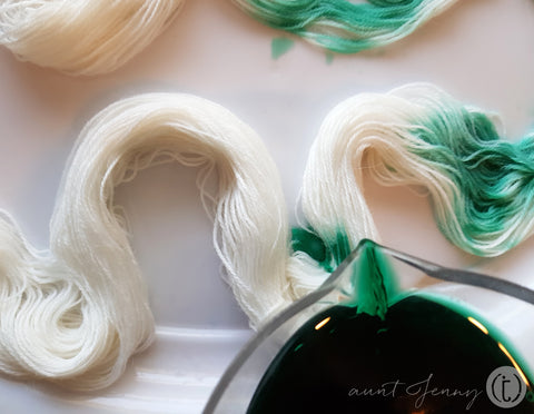 Emerald green dye being poured into yarn