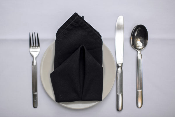 3 Napkin-Folding Techniques to Take Your Dinner Party's Tablescape to the Next Level