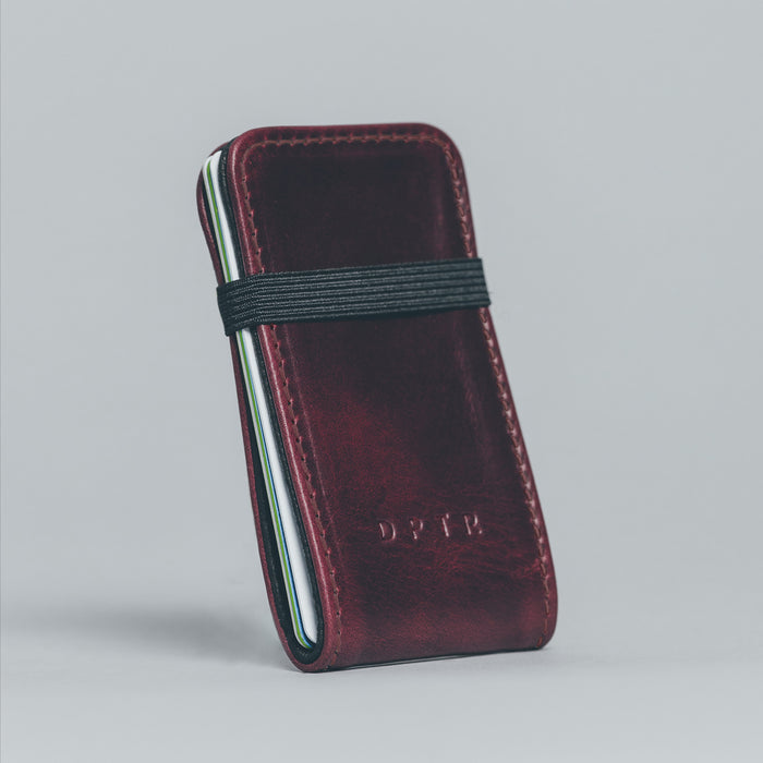 CLAMSHELL WALLET . OXBLOOD