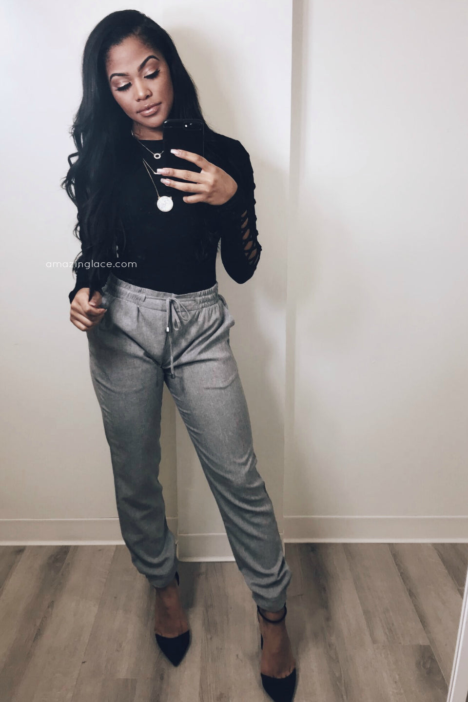 BLACK BODYSUIT AND GRAY DRAWSTRING PANTS OUTFIT