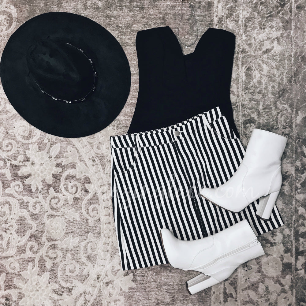 BLACK BODYSUIT AND STRIPED SKIRT OUTFIT