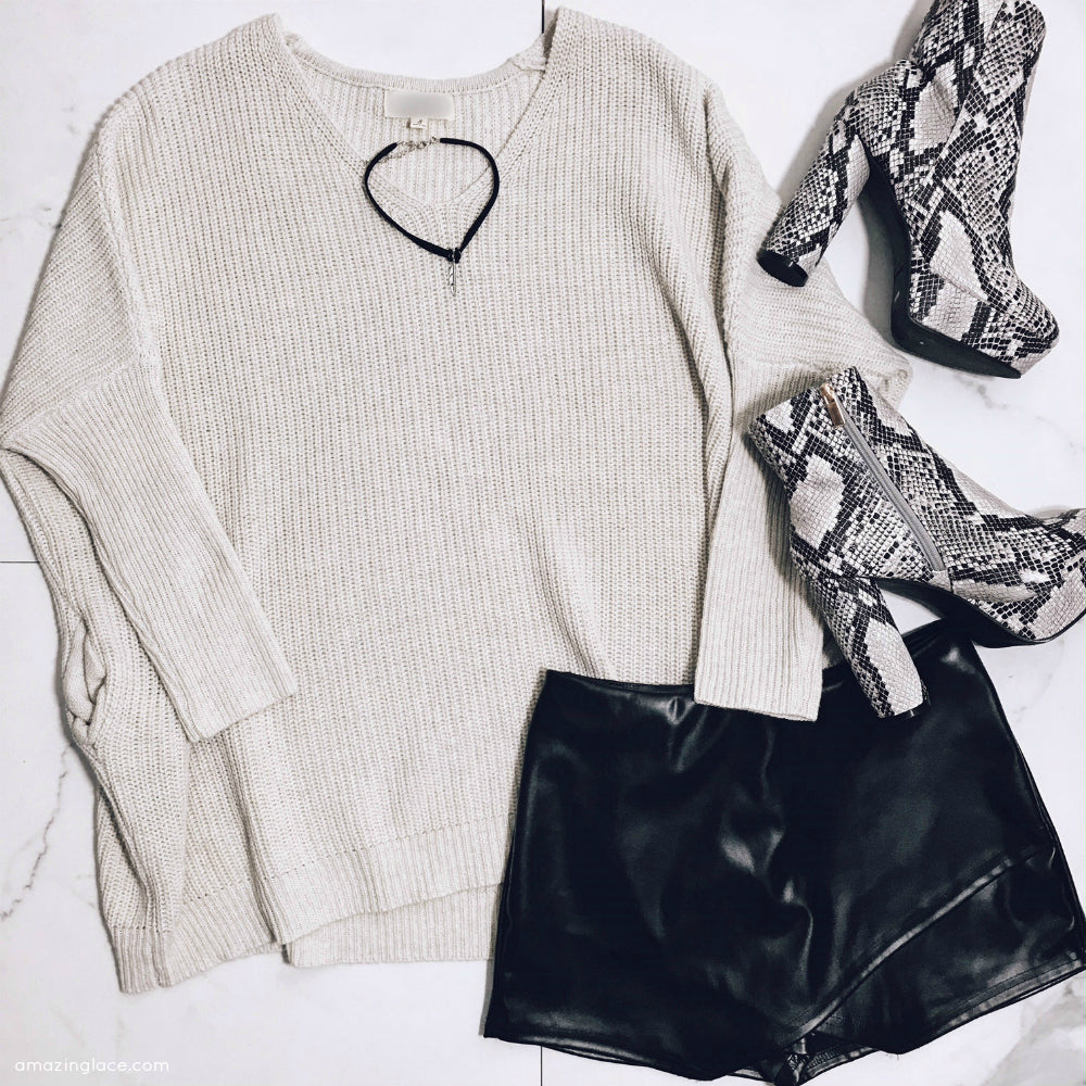 IVORY SWEATER AND BLACK SKORT WITH SNAKE SKIN BOOTS OUTFIT