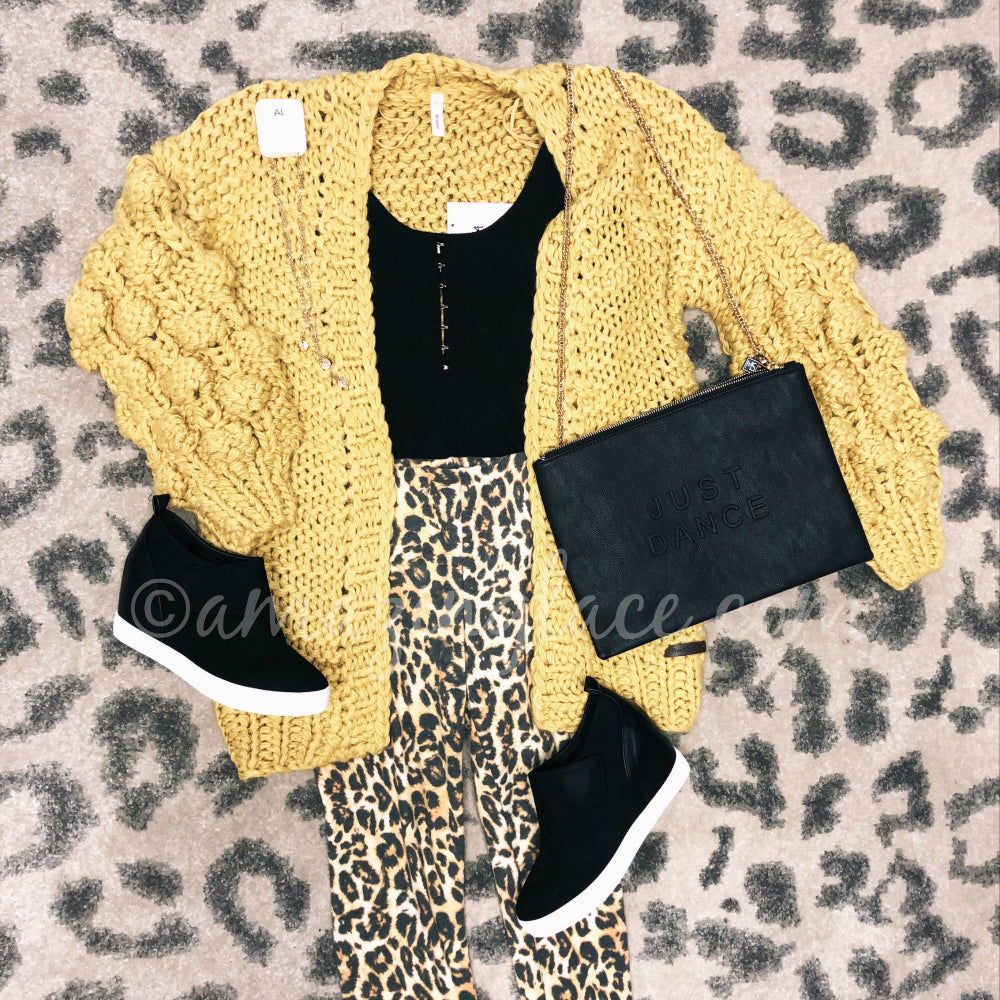 MUSTARD CARDI WITH AMUSE SOOCIETY BODYSUIT, LEOPARD LEGGINGS AND BLACK SNEAKERS OUTFIT