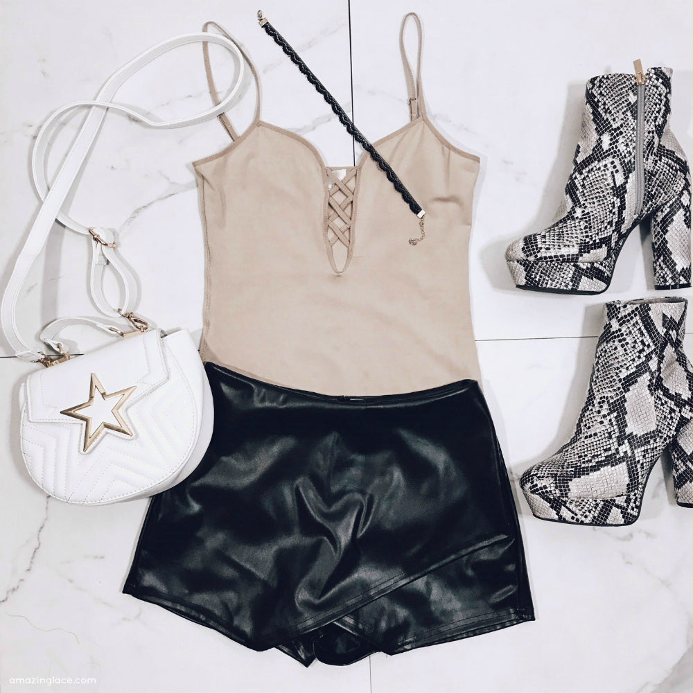 NUDE BODYSUIT BLACK SKORT AND STAR BAG OUTFIT