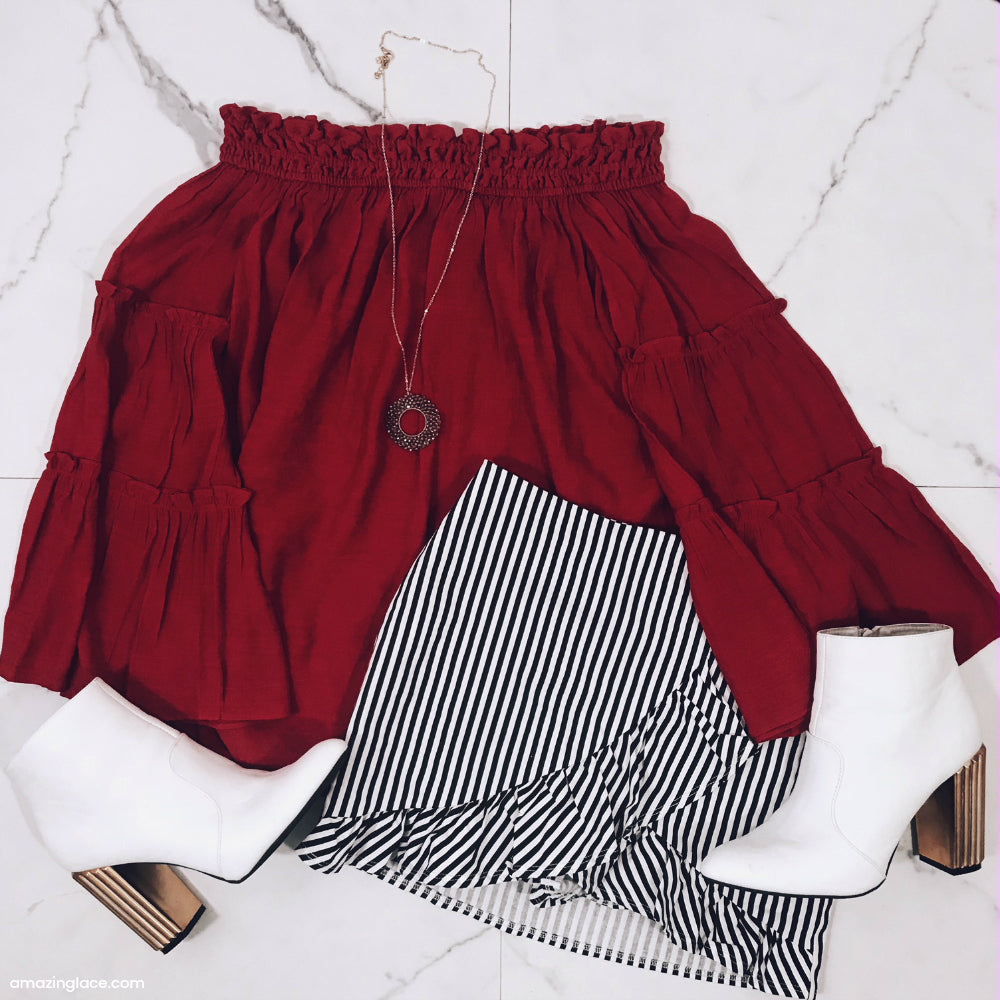 RED OFF THE SHOULDER TOP AND STRIPED SKORT OUTFIT