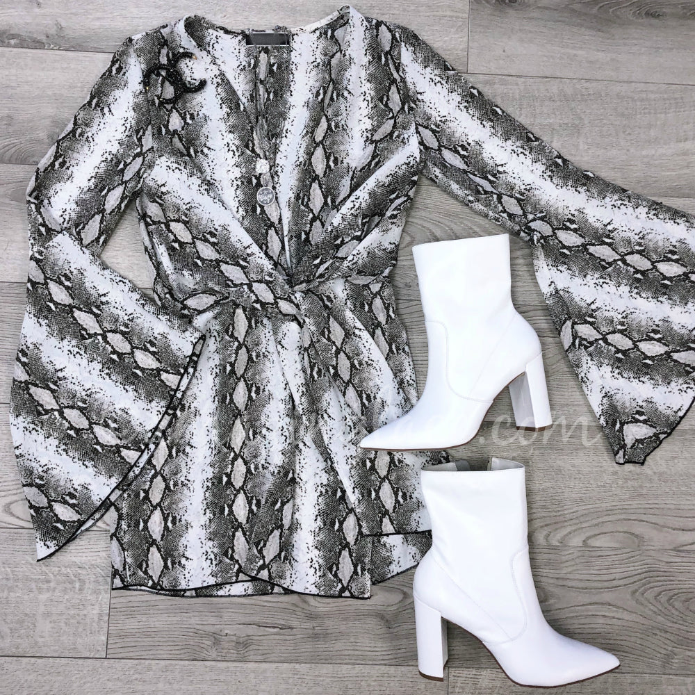 PLUNGING SNAKE DRESS AND WHITE POINTED BOOTIES