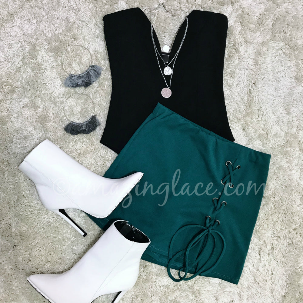 BLACK BODYSUIT AND KELLY GREEN LACE UP SKORT OUTFIT